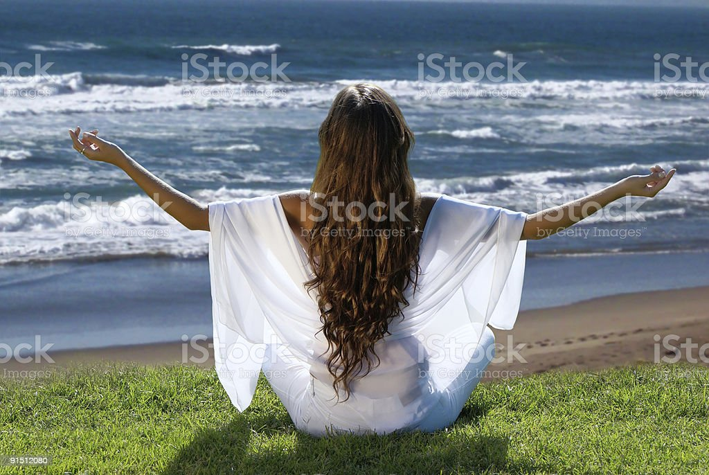 meditation of woman against ocean royalty-free stock photo
