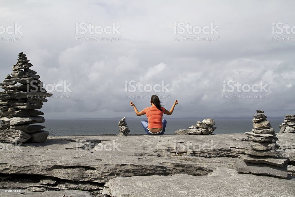 Meditation on rocky coast royalty-free stock photo