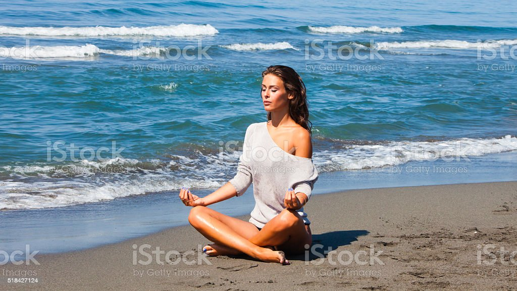 Meditation on the beach stock photo