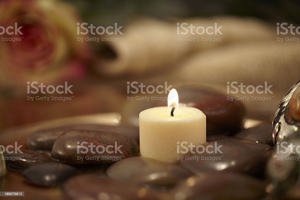Meditation setting with stone and candles royalty-free stock photo