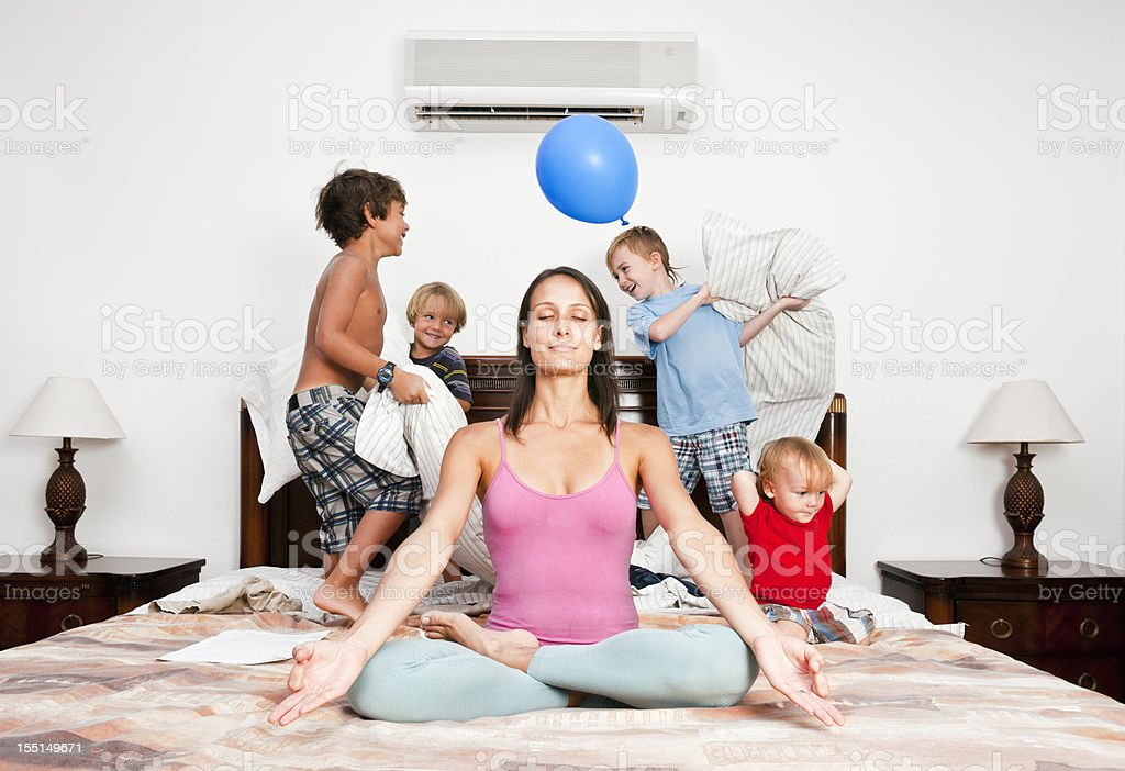 Meditation time, yoga, mother, relaxation. stock photo