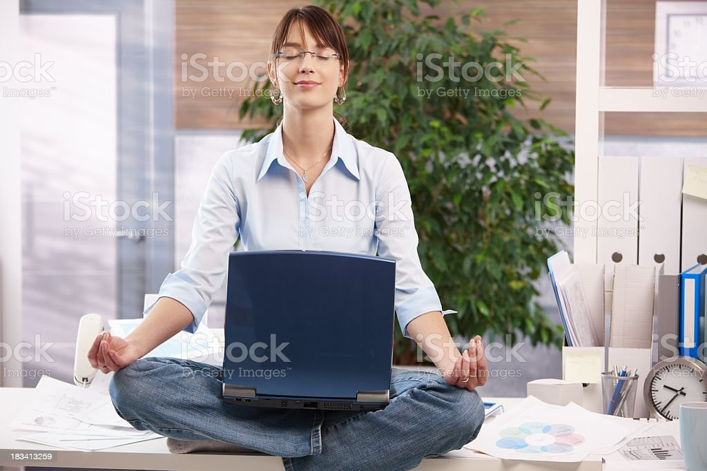 Meditation with laptop royalty-free stock photo