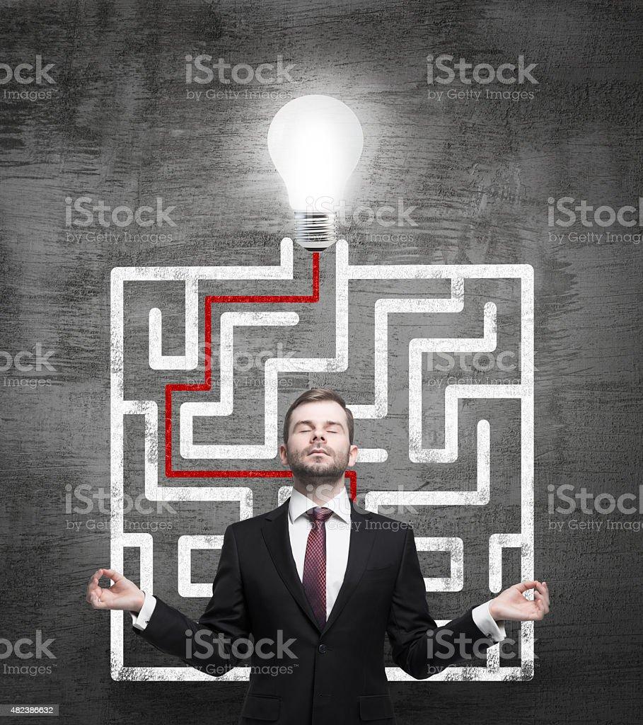 Meditative businessman and solved labyrinth stock photo