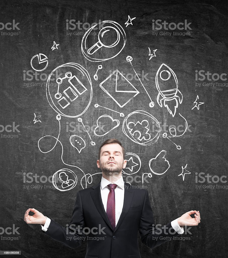 Meditative businessman stock photo