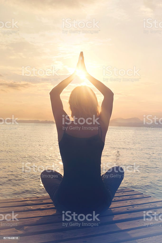 Meditative woman is in harmony with itself and the nature stock photo