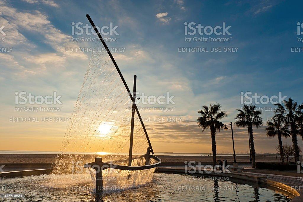 Mediterranean beach fountain sunrise Valencia Spain stock photo