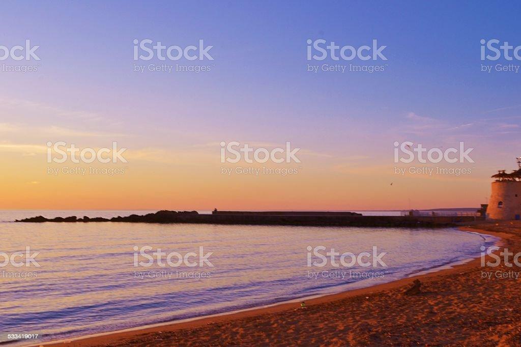 Mediterranean beaches. Gallipoli's sea at sunset stock photo