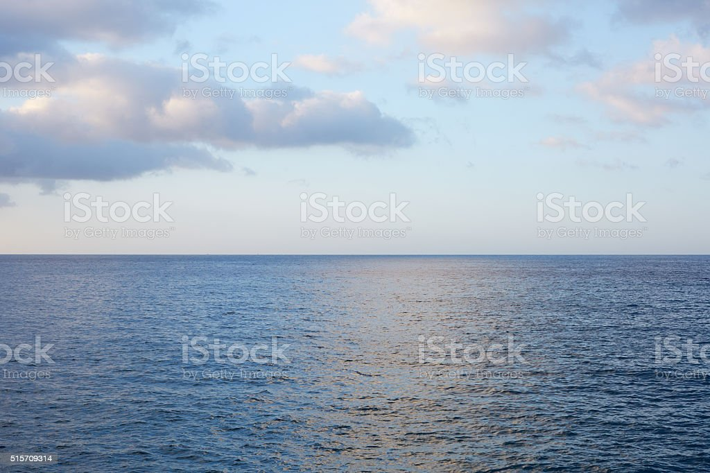 Mediterranean blue, calm sea with horizon in the morning stock photo