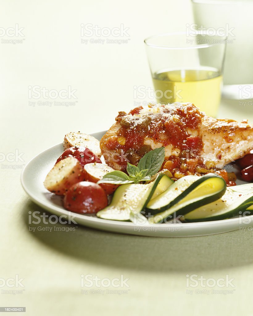 Mediterranean Chicken with wine glass royalty-free stock photo