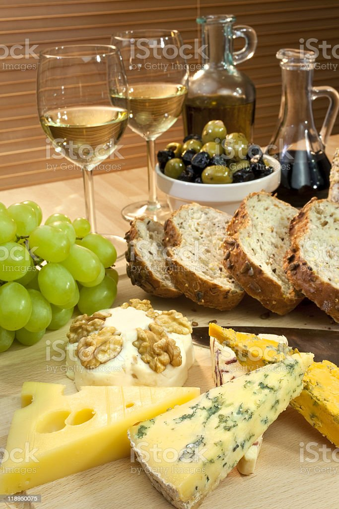 Mediterranean Diet of Cheese, Wine, Grapes, Olives, Bread Balsma stock photo