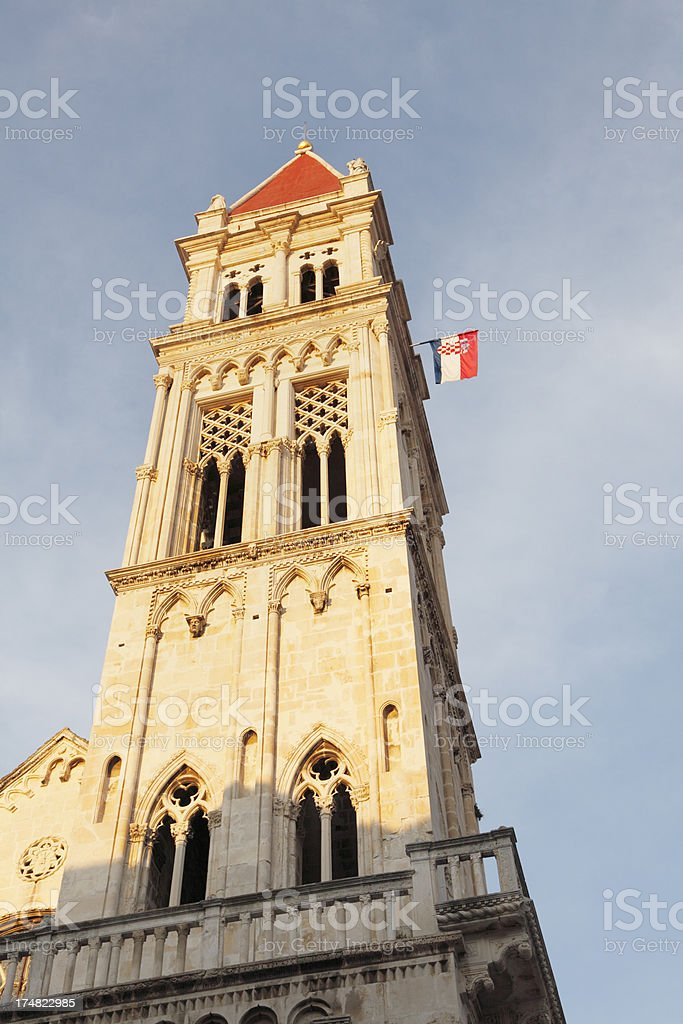 mediterranean historic church bell towers roofs flag Trogir Croatia royalty-free stock photo