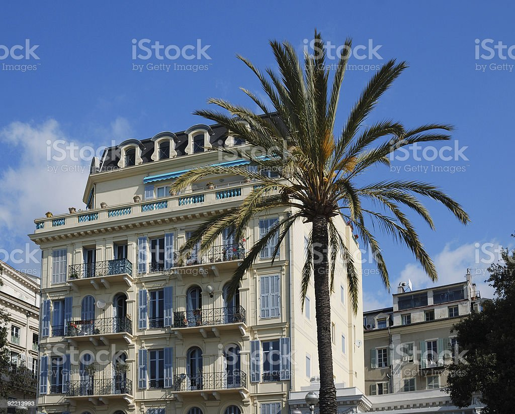 Mediterranean hotel in sea-front and lofty palms, Nice royalty-free stock photo