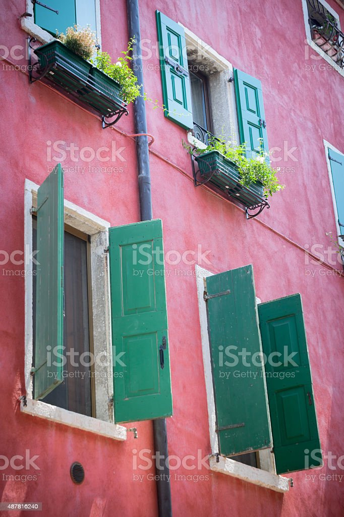 mediterranean house with shutters stock photo