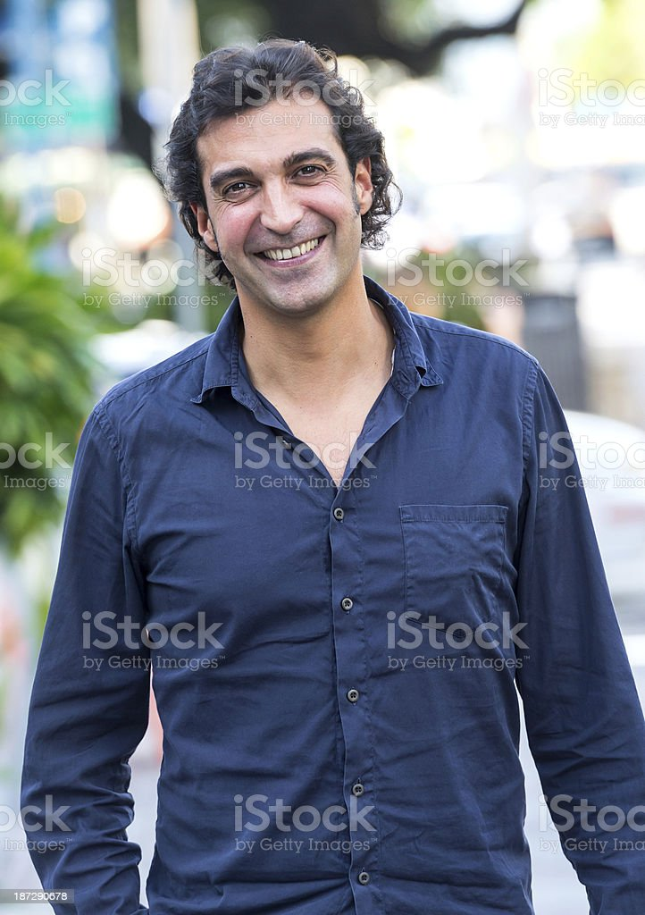 Mediterranean man smiling for a pose royalty-free stock photo