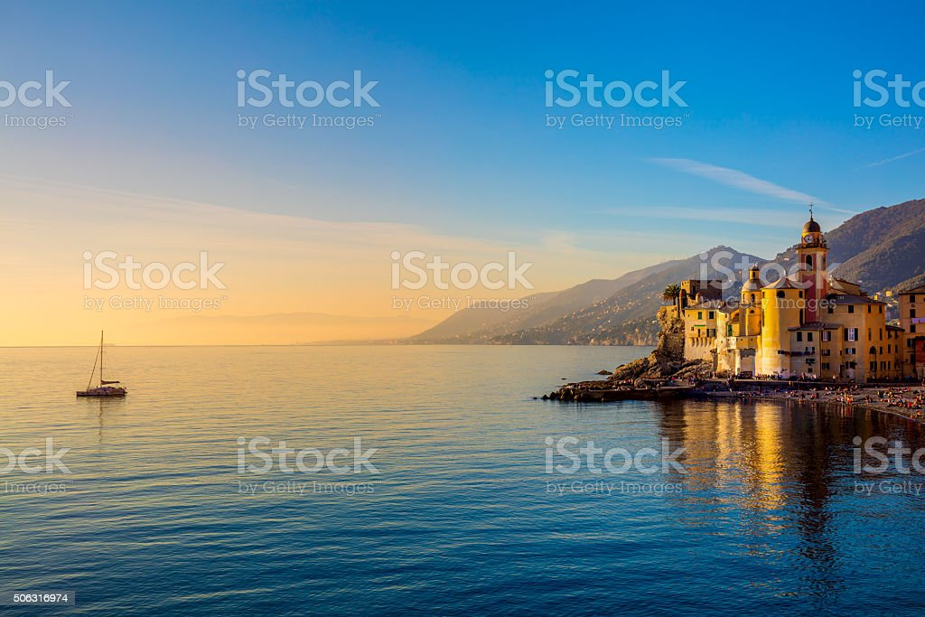 Mediterranean Sea at sunrise, small town and yacht stock photo