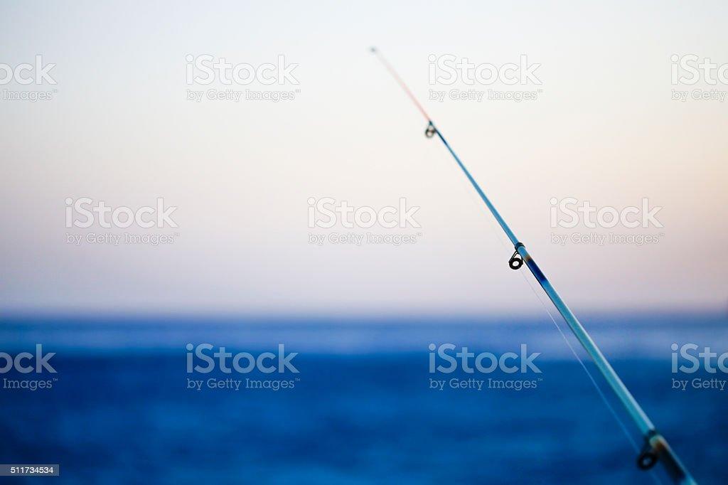 Mediterranean sea fishing rod stock photo