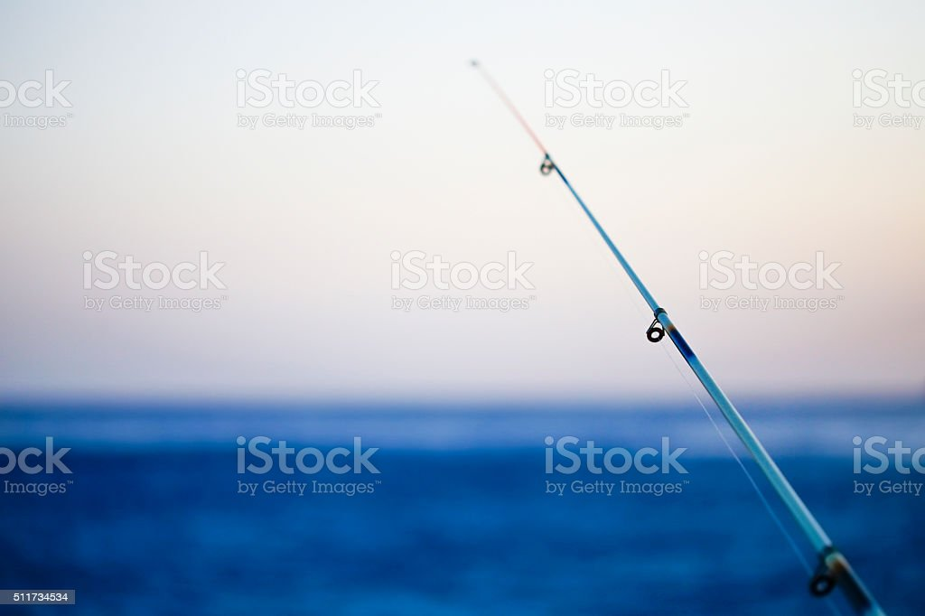 Mediterranean sea fishing rod stock photo