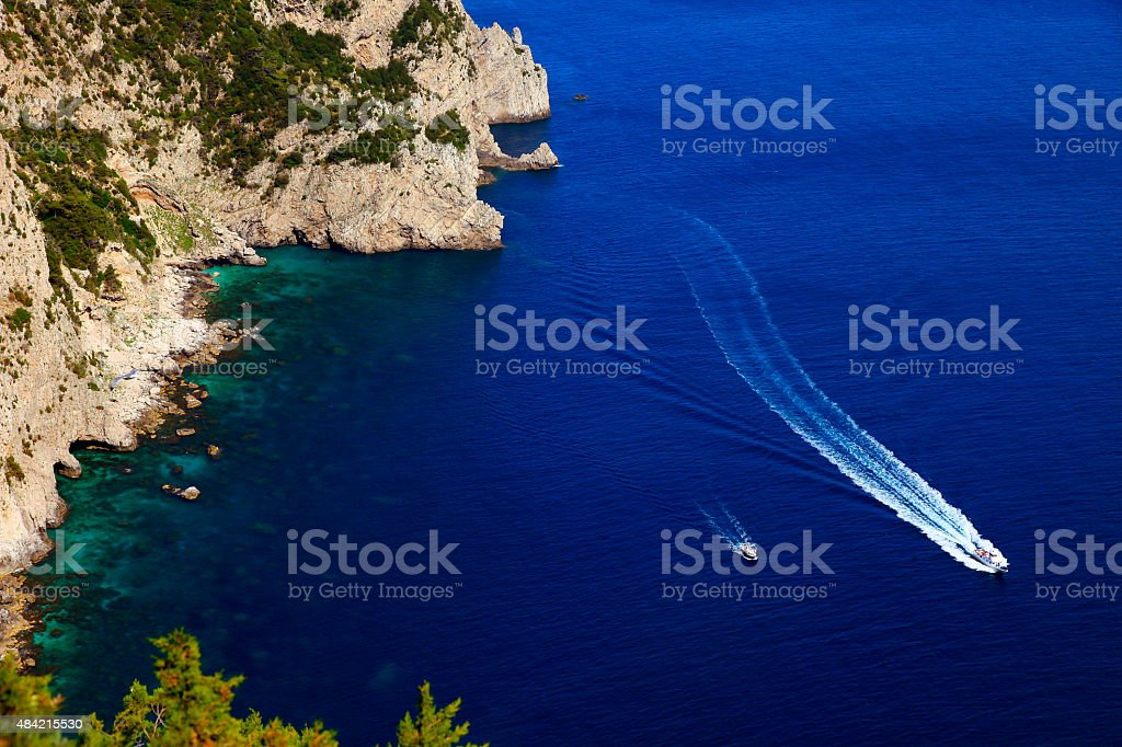 Mediterranean sea from above Capri Cliff and ships crossing water stock photo