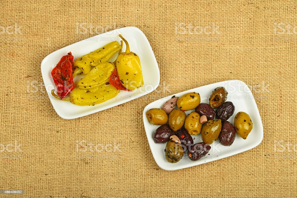 Mediterranean snack of olives and pickled pepper on canvas royalty-free stock photo