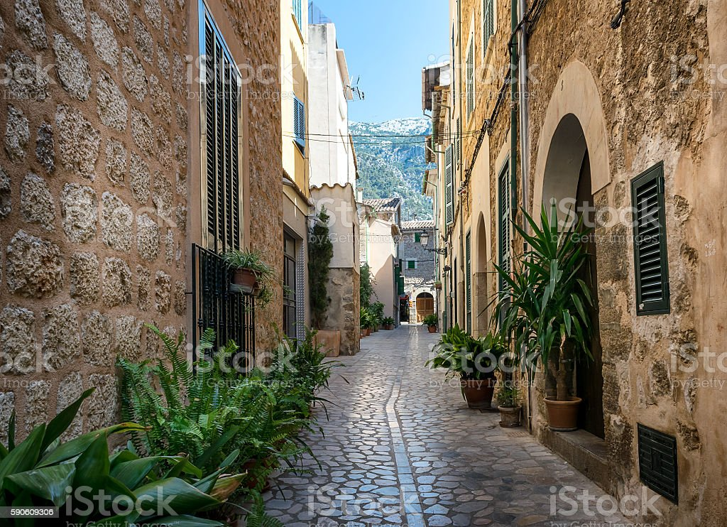 Mediterranean street with flower pots in facades at Spain stock photo