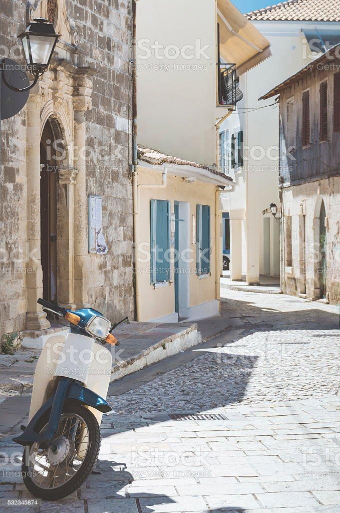 Mediterranean street with vintage motorcycle stock photo