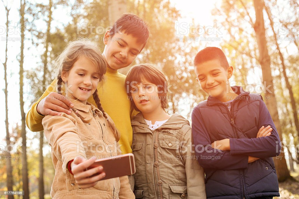 Medium group of kids making self portrait. stock photo