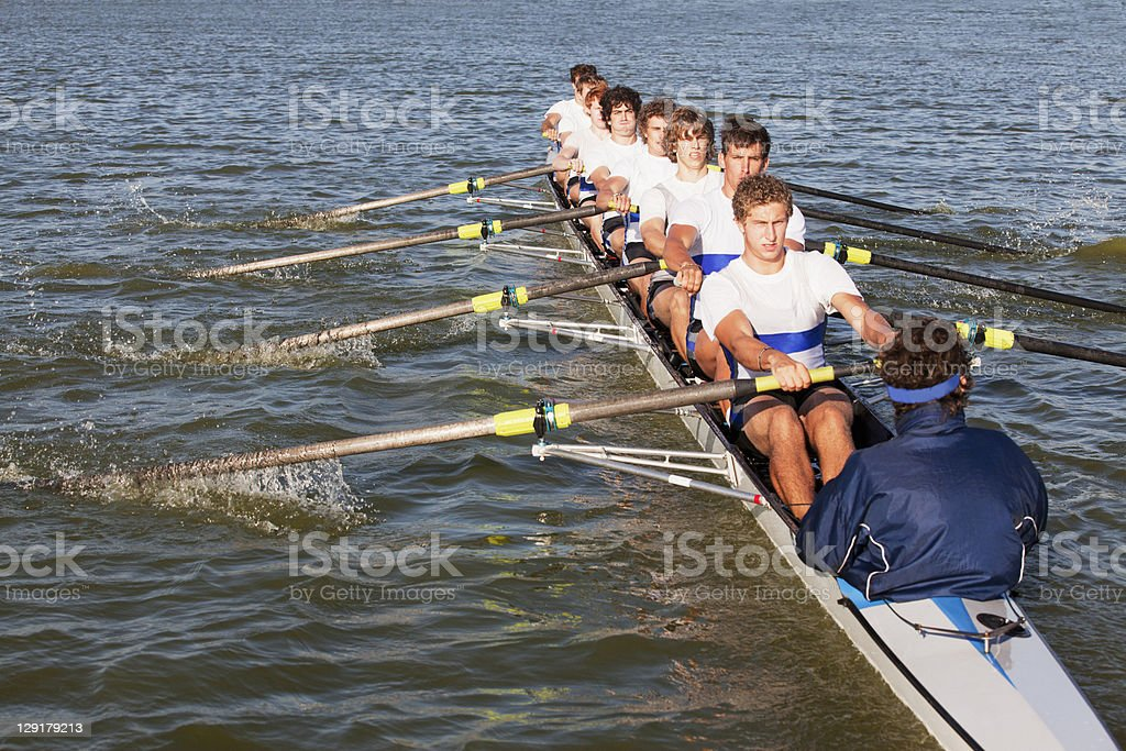 Medium group of people oaring canoe stock photo
