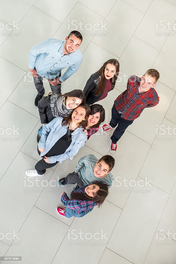 Medium group of students in the school building. stock photo