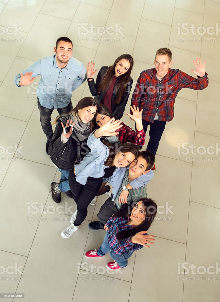 Medium group of students in the school building stock photo