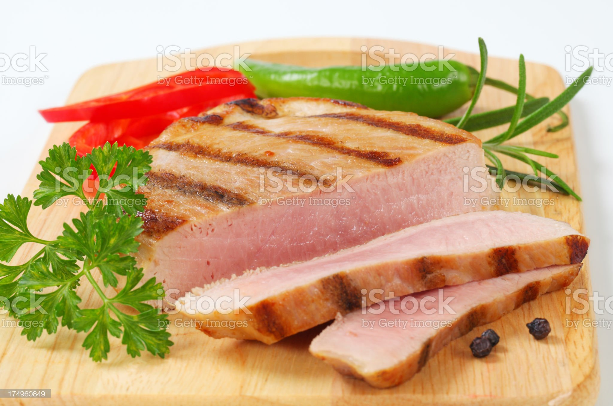 medium pork steak with spices on a cutting board royalty-free stock photo