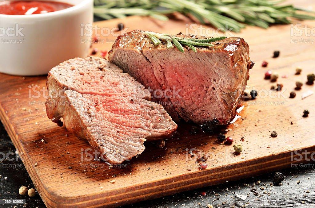 Medium Rare Filet mignon steak on wooden board, selected focus stock photo