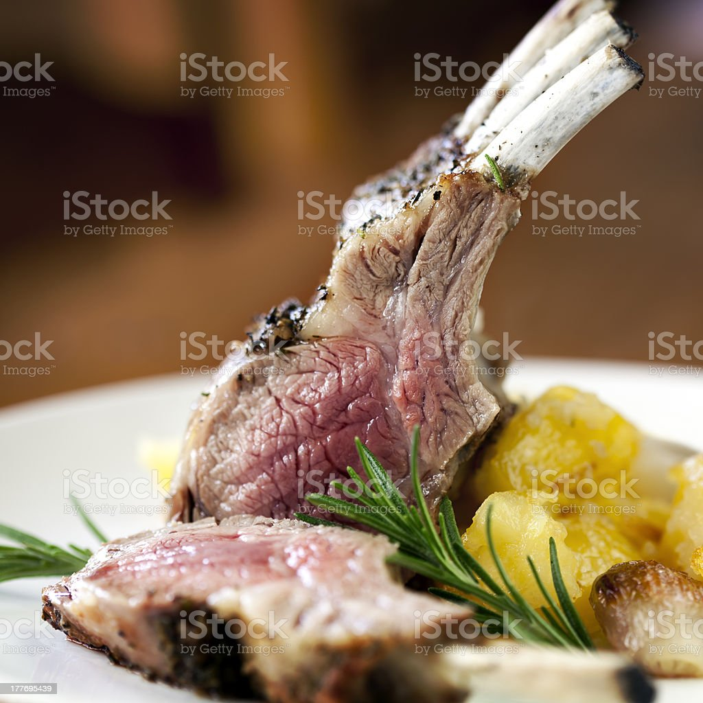 Medium rare rack of lamb next to squash stock photo