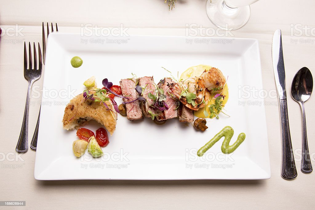 Medium Rare Sliced Steak, Shrimp and Scallops stock photo
