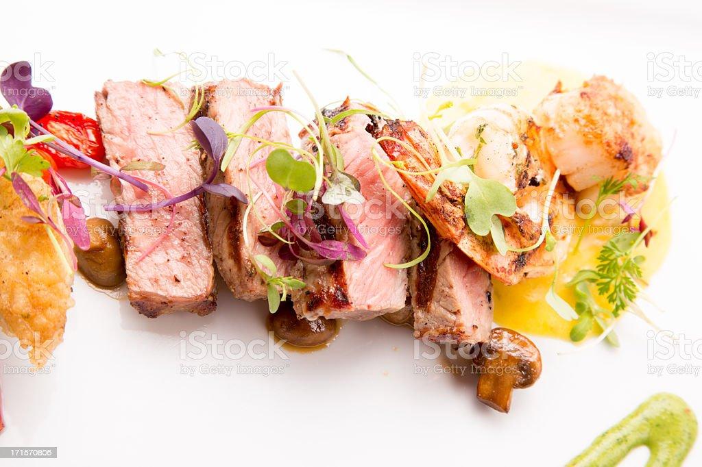Medium Rare Sliced Steak, Shrimp and Scallops royalty-free stock photo