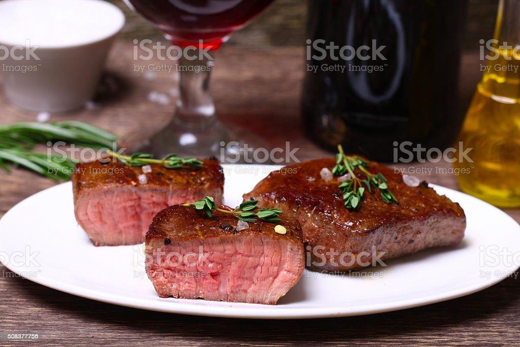 medium roast rib-eye steak with pepper, thyme and salt stock photo
