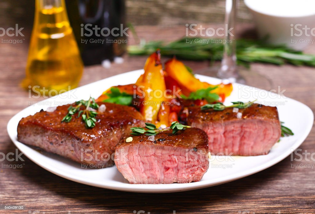 medium roast rib-eye steak with pepper, thyme and salt stock photo