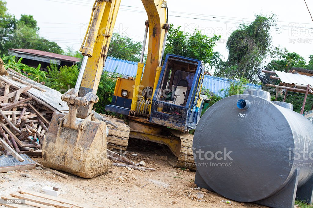 Medium sized Excavator  with waste water treatment tank stock photo