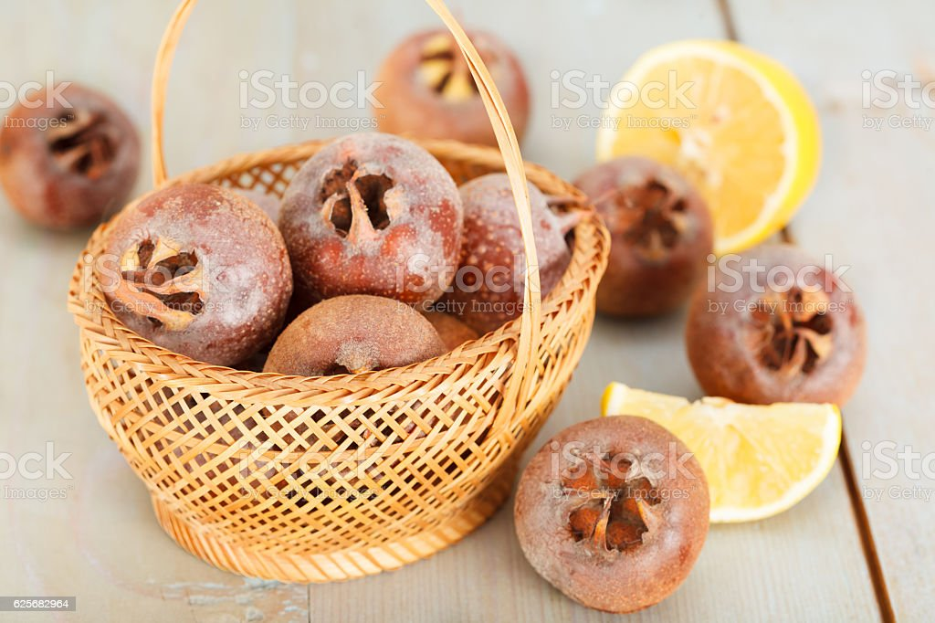 Medlar fruit in the basket. stock photo
