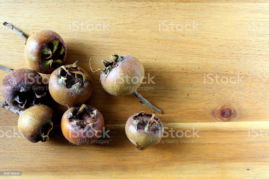 medlar fruits on a wooden board stock photo