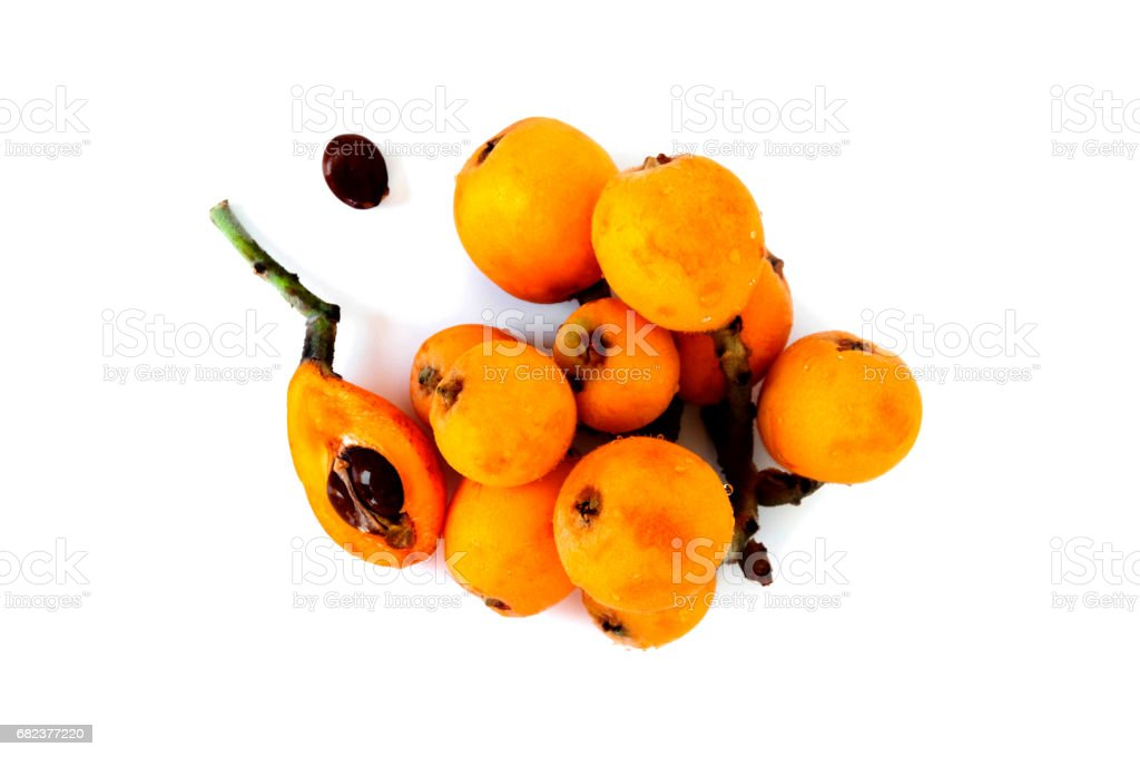 medlar or loquat fruits isolated on a white background stock photo