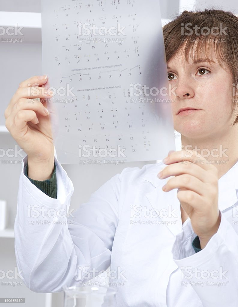 Medtech checks results of  cariotype test stock photo