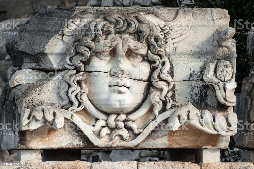 Medusa head in ancient Temple of Apollo in Didim, Turkey stock photo