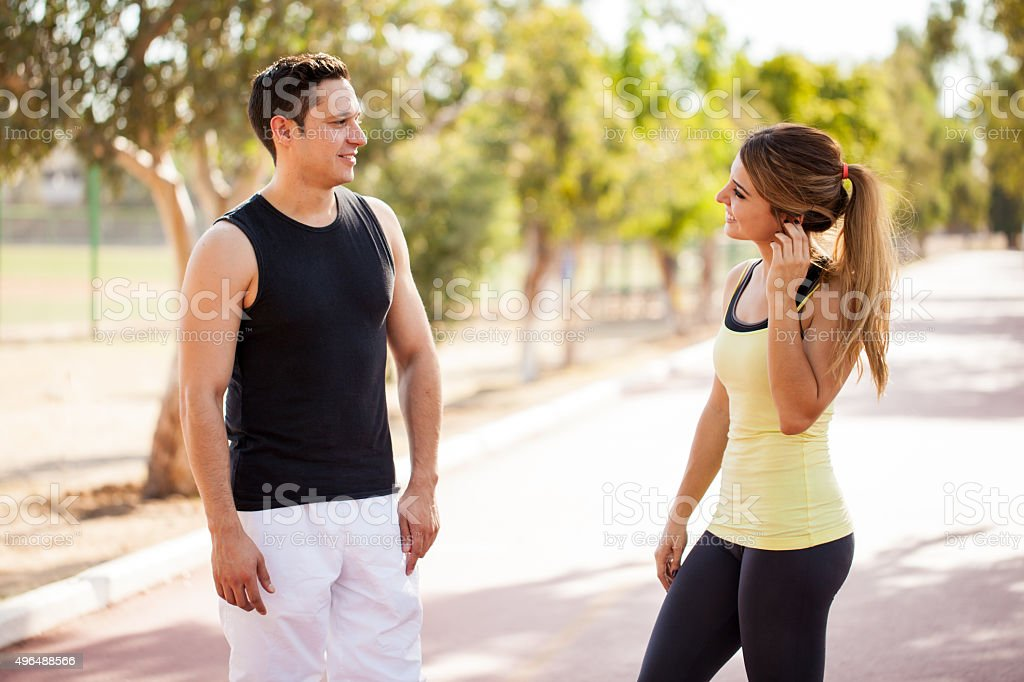Meeting a girl while working out stock photo