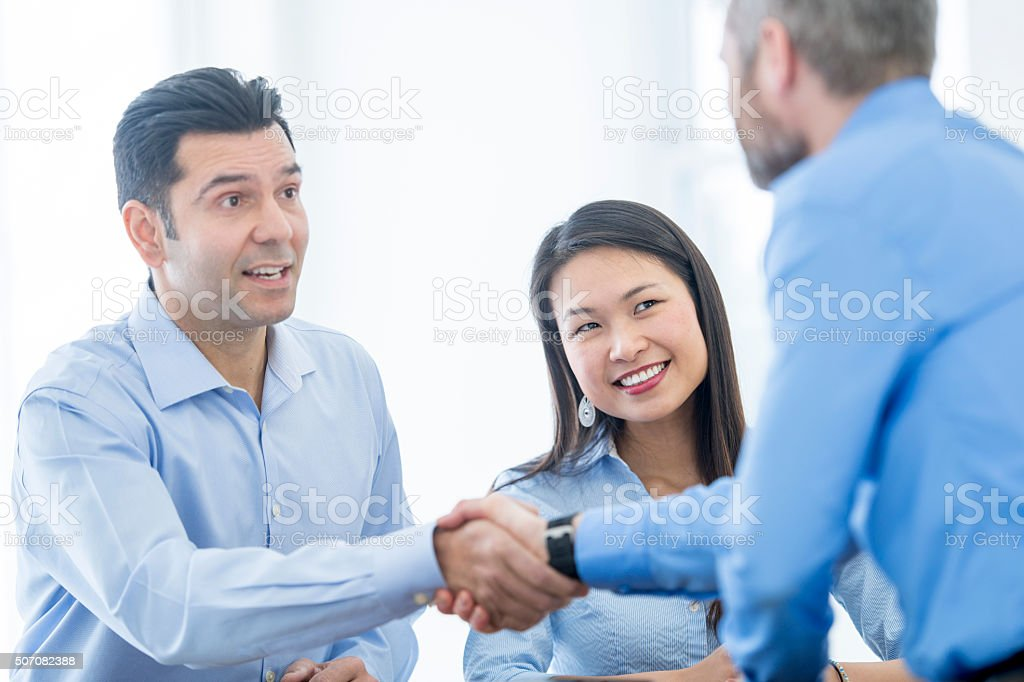 Meeting a New Associate at Work stock photo
