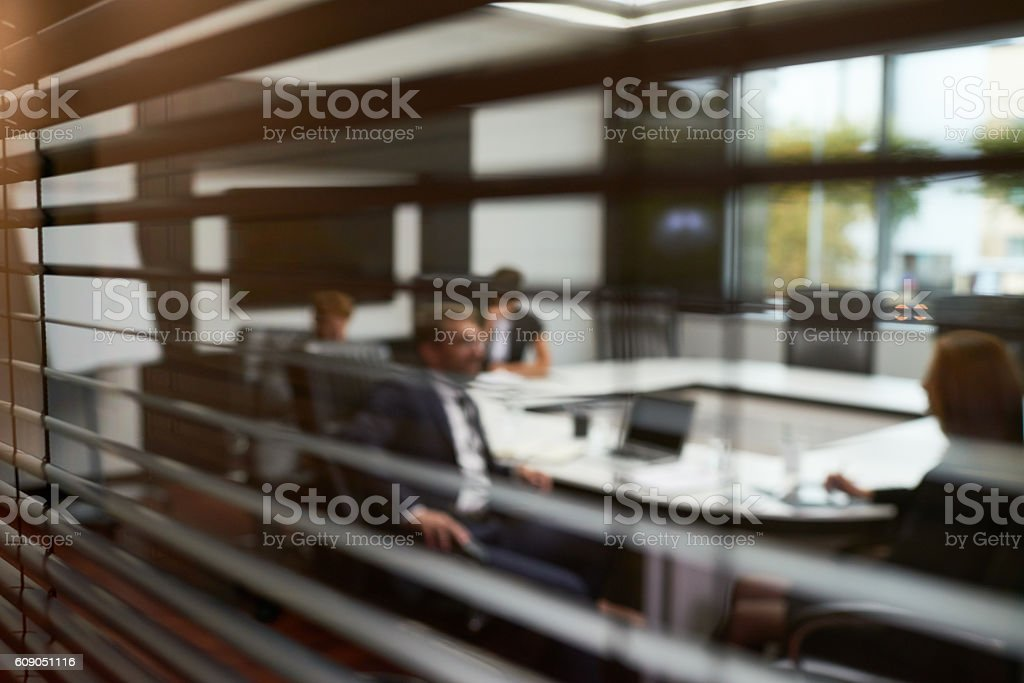 Meeting behind shutters stock photo