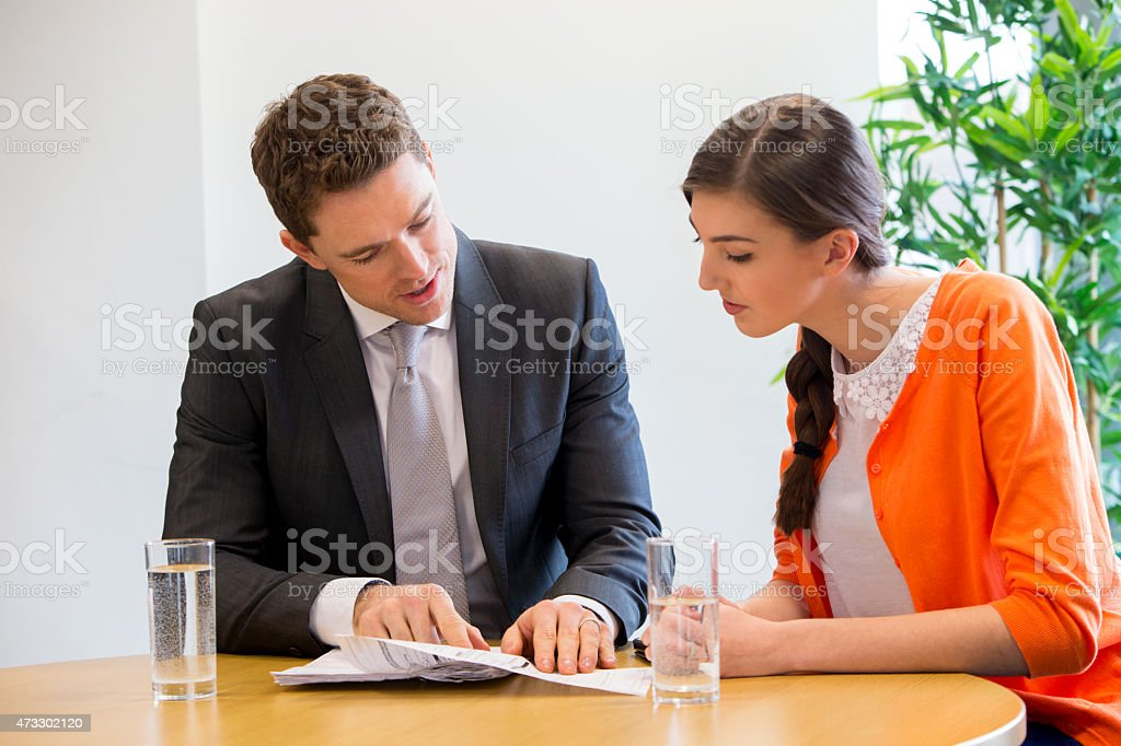 Meeting Between Female Student and Teacher stock photo