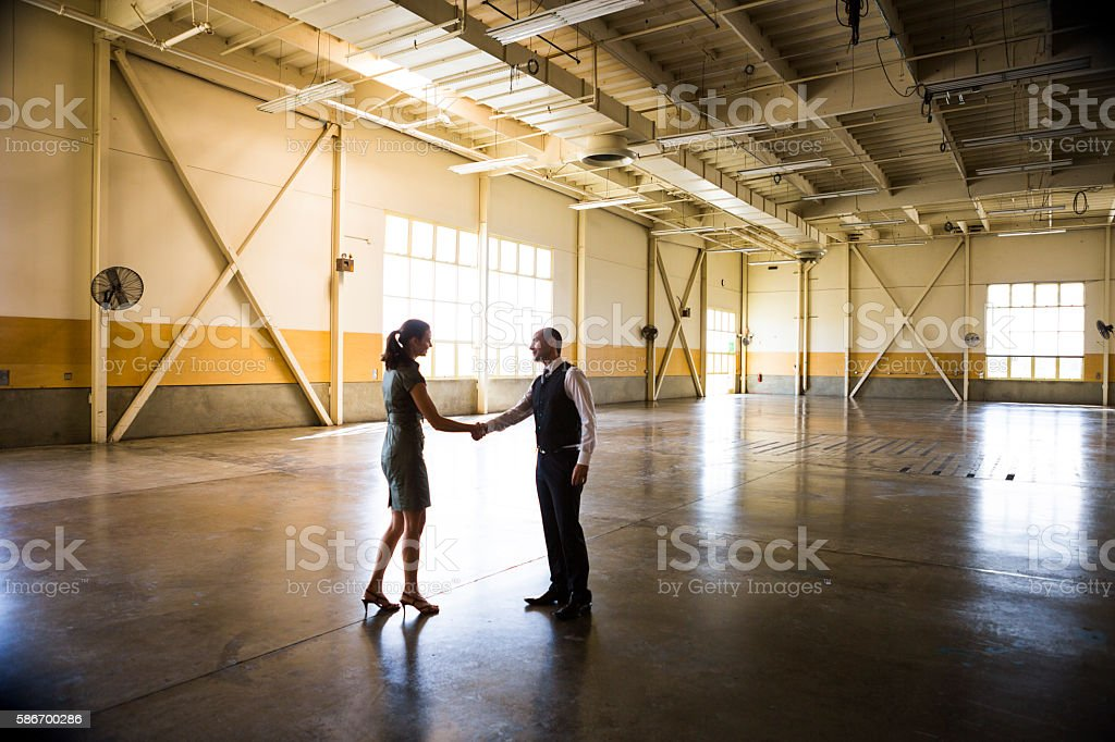 Meeting in Empty Office Warehouse stock photo