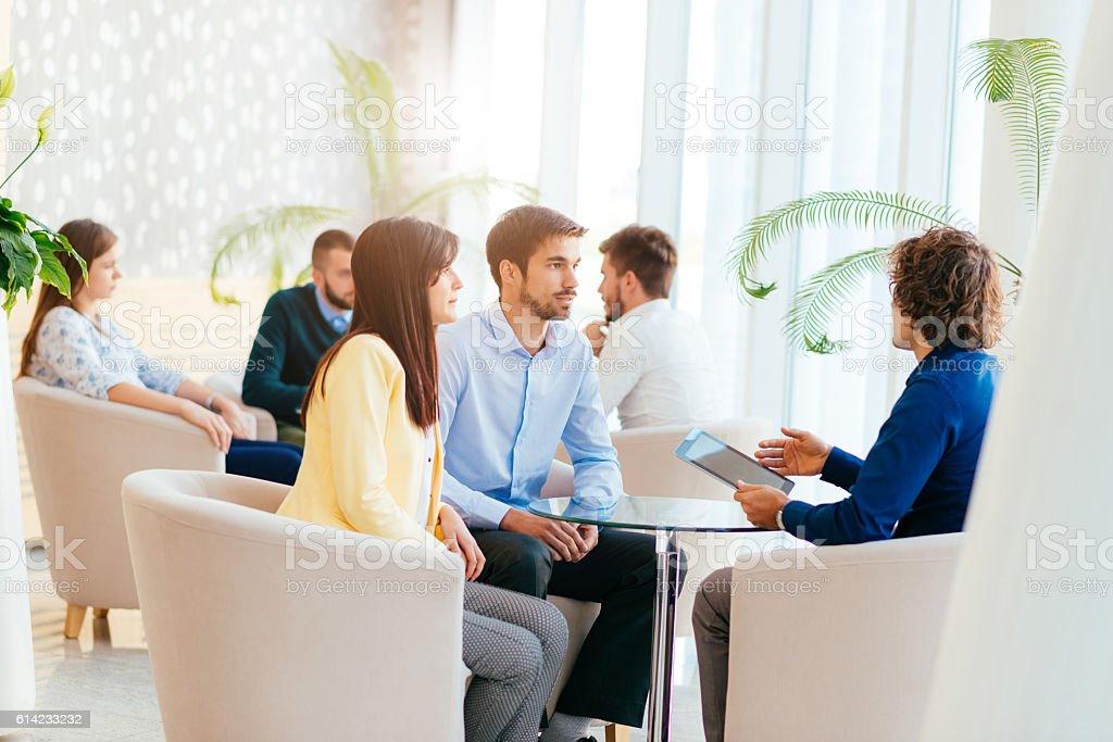 Meeting in hotel lobby stock photo