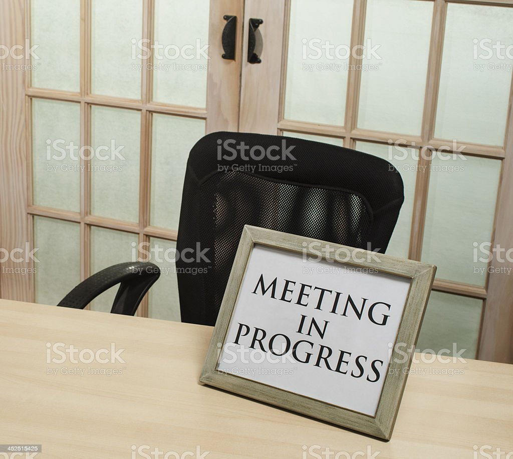 meeting in progress sign royalty-free stock photo