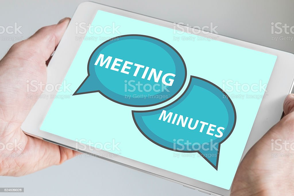 Meeting minutes concept with hands holding tablet stock photo